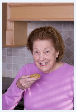 Elderly woman with cookie