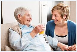 Elderly woman chatting with younger woman