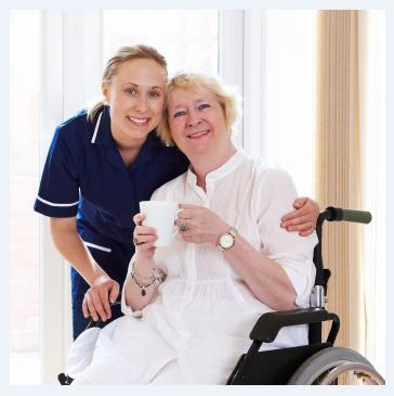 Caregiver with a woman in a wheelchair